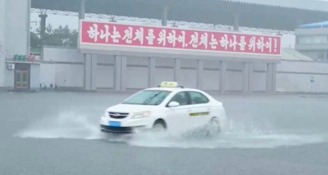 Thousands of homes, farms hit by floods in NKorea: state TV