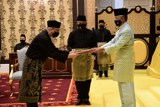 Malaysian PM sworn in as scandal-hit party reclaims leadership