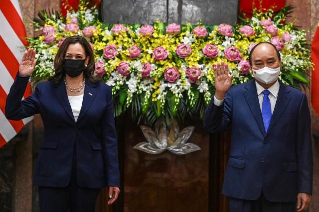 Harris in Hanoi as Afghan debacle rumbles