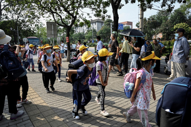 China races to squash new Covid-19 cluster among schoolchildren