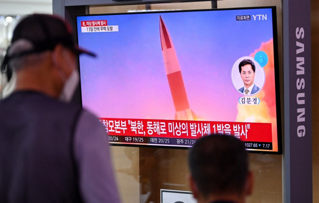 North Korea fires 'projectile', insists on right to weapons tests