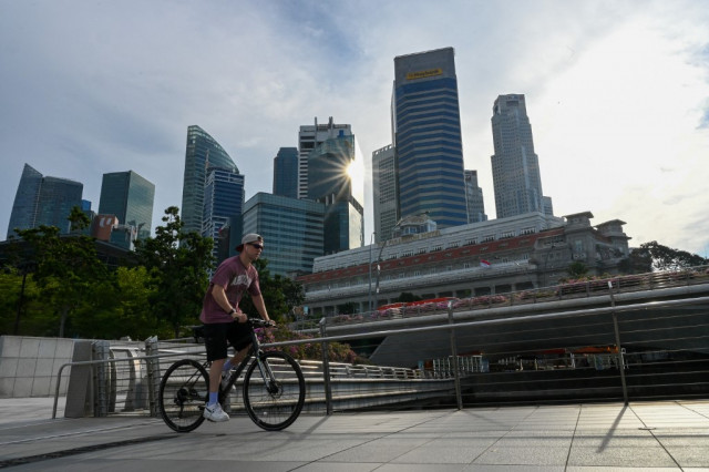 Singapore tightens monetary policy as virus-hit economy recovers