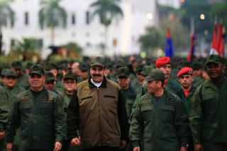 Maduro rallies military as Venezuela opposition appeals to troops