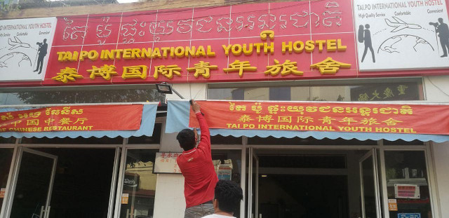 Chinese-Owned Hostel Sign Removed in Siem Reap City