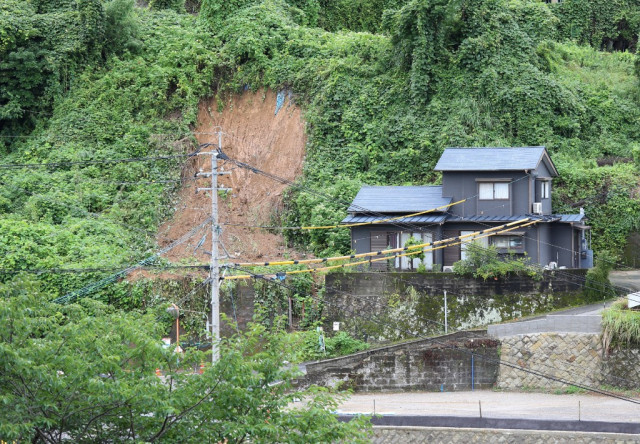 Japan on landslide alert as heavy rains lash south