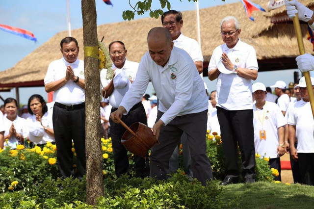 King Sihamoni urges Cambodians to plant trees, inviting newlyweds to do so at their weddings