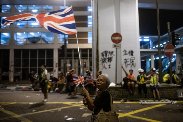 Chinese envoy and media condemn Hong Kong protest against Beijing office