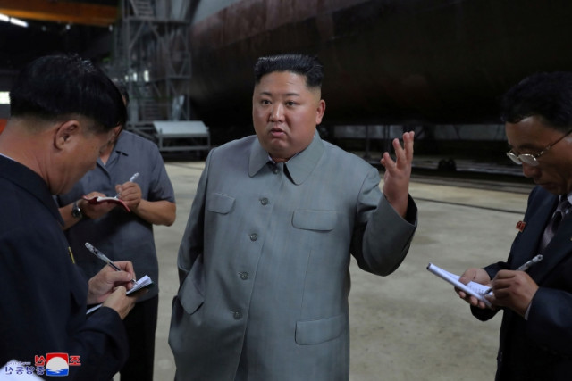 DPRK's Kim Jong Un inspects newly built submarine