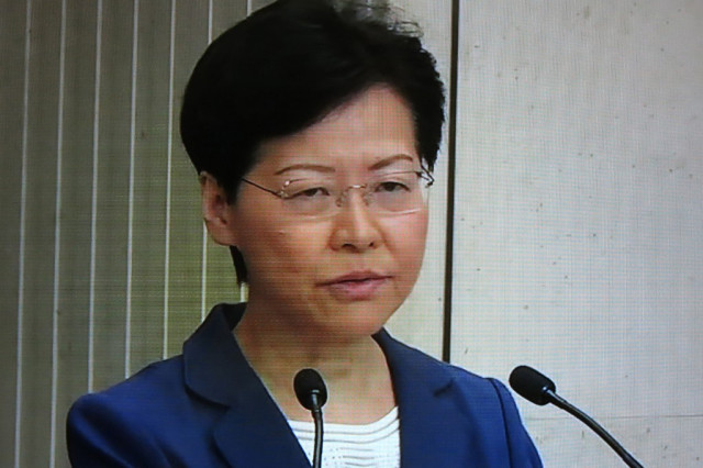 When will you die?' Hong Kong leader grilled at press conference