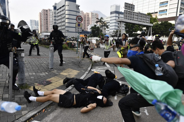 Hong Kong police fire tear gas as clashes return to city streets