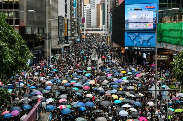 Flouting police ban, Hong Kong protesters flood city streets