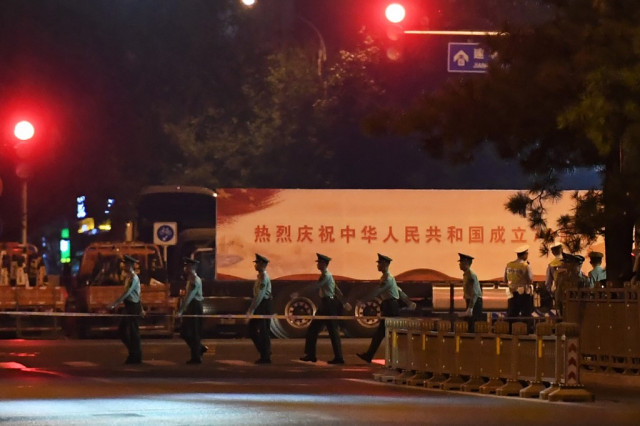 Central Beijing locked down for overnight army parade rehearsal