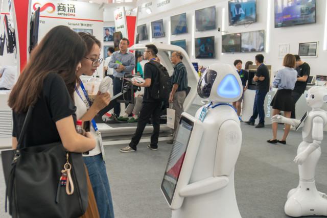 Tech China Weekly: AI pilot zones; robot standard; artificial heart; 5G base stations