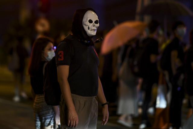 Hong Kong mask ban sparks violent clashes, rail shutdown