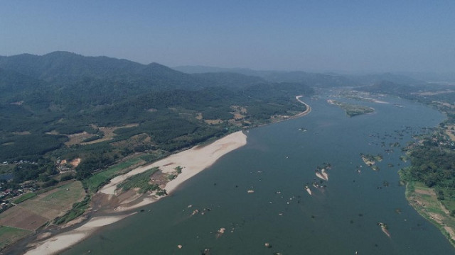 Low flows turn Mekong aquamarine hue in Laos and Thailand