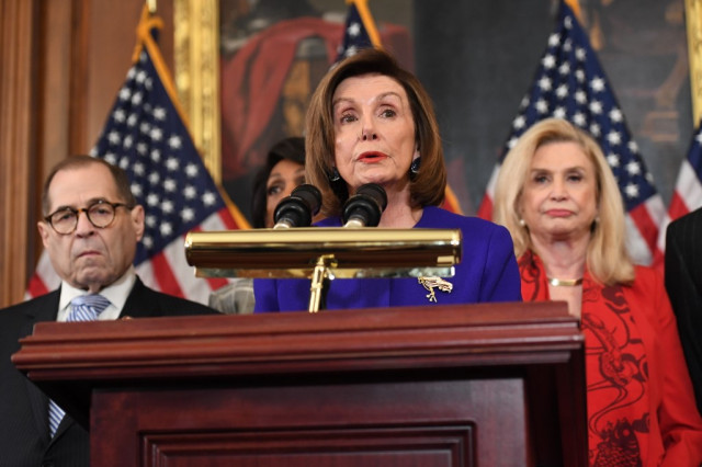 Democrats announce two impeachment charges against Trump