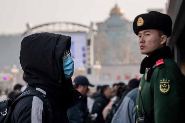 China says virus spreading between humans as WHO set to meet