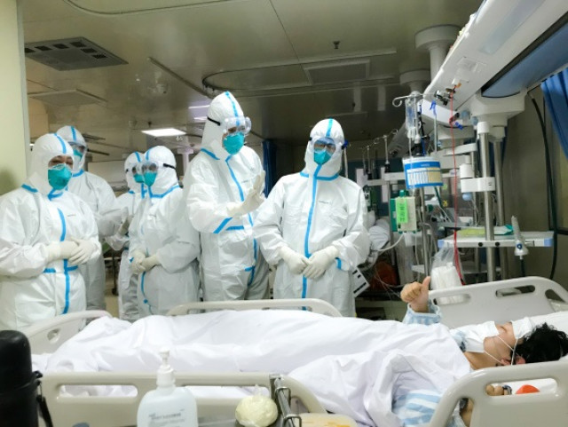 Wuhan hospitals receive over 15,000 fever patients daily