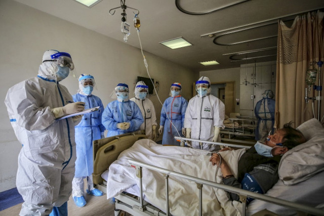 China reports 22 new virus deaths as imported cases rise