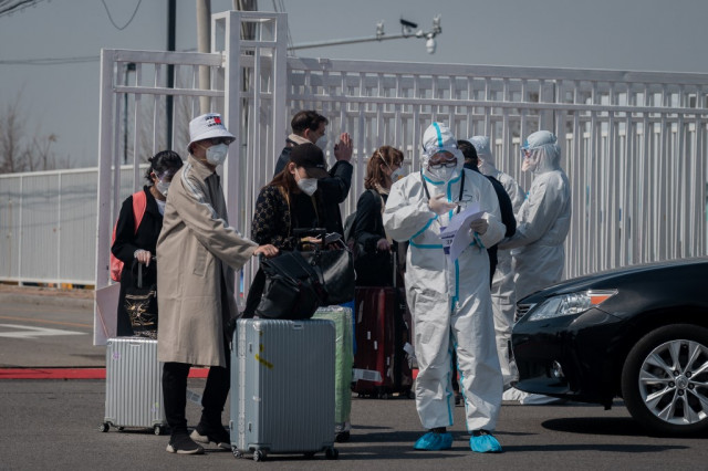 China tightens quarantine for international arrivals