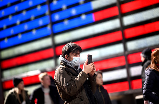Americans urged to wear masks as virus toll mounts around world