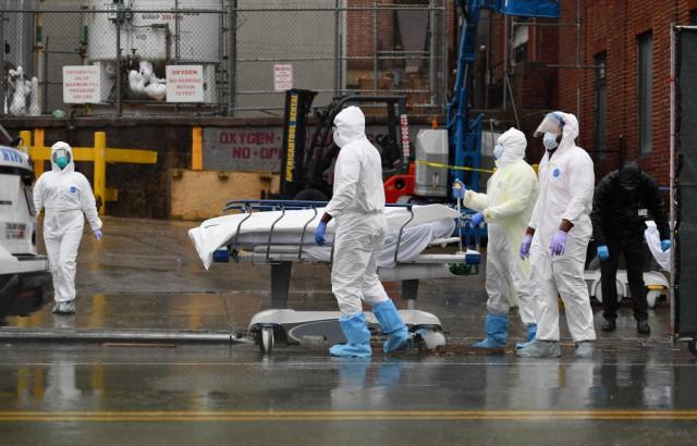 Virus deaths top 100,000 ahead of locked-down Easter