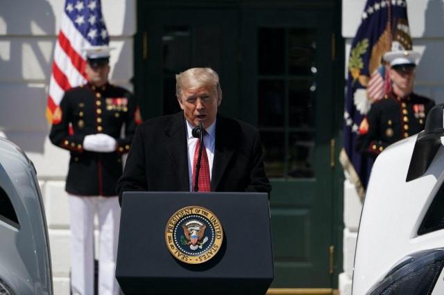 Trump announces gradual US reopening against dire economic backdrop
