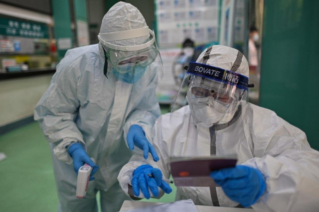 China's Wuhan raises virus death toll by 1,290, up 50%