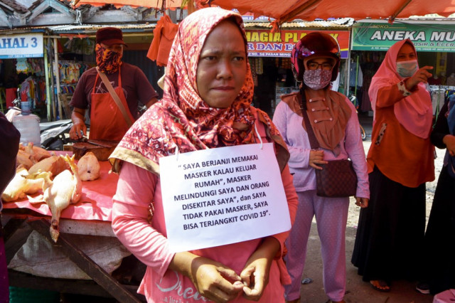 Indonesia rolls out public shaming for virus violators