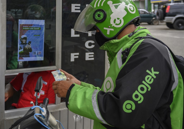 Indonesia's GoJek latest app to cut jobs as virus takes toll