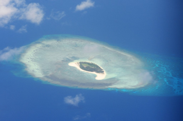 Australia rejects Beijing's South China Sea claims, backing US