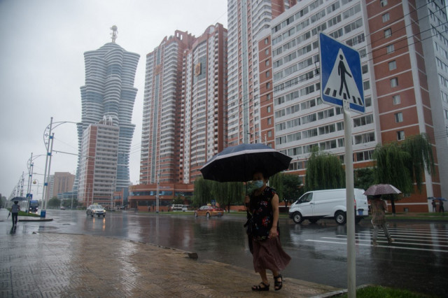 North Korea on flood alert as heavy rain kills 16 in South