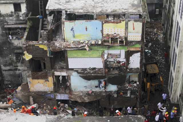 Ten dead, up to 25 feared trapped in India building collapse
