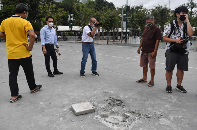 Thai protesters vow to fight after 'people's plaque' removed