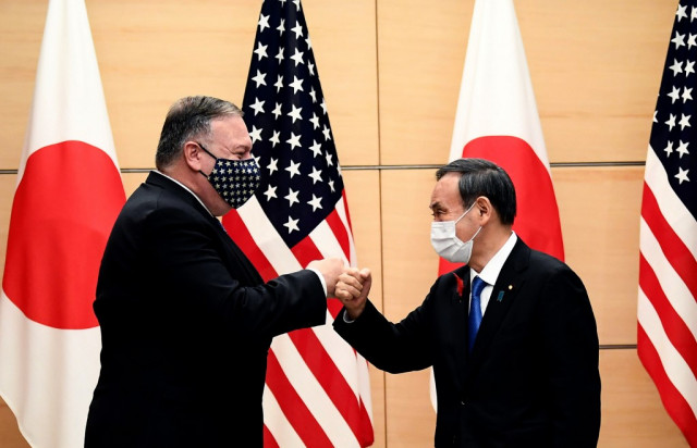Pompeo slams China's 'corruption, coercion' at Tokyo talks