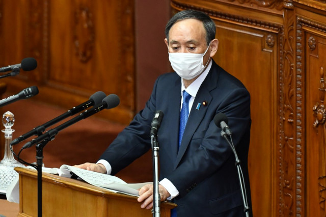 Japan PM vows to tackle virus as public support plunges