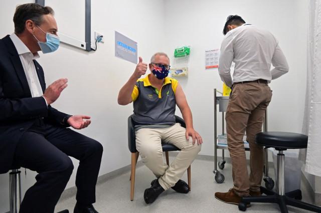 Australia starts vaccine rollout amid controversy