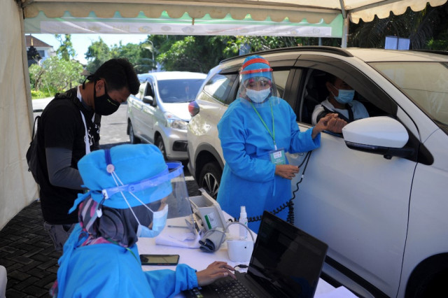 Bali kicks off drive-thru virus jabs for hospitality workers
