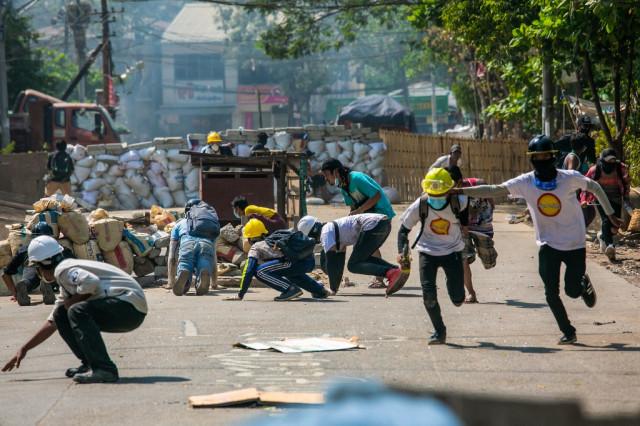 Myanmar military forces civilians to dismantle Yangon barricades