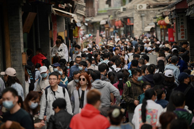 Chinese tourists out in force as virus fears recede